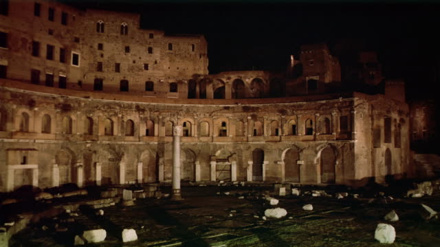 Wide shot view of the column in Trajan's Forum at night / Rome