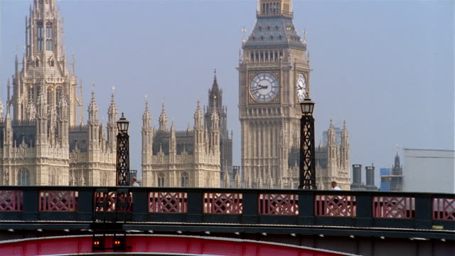 wide shot view of traffic crossing lambeth bridge, big ben and spires of westminster palace / london - westminster bridge stock videos and b-roll footage