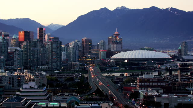Wide shot View overlooking downtown, Cambie Bridge, and BC Place Stadium along False Creek/ Vancouver, British Columbia, Canada