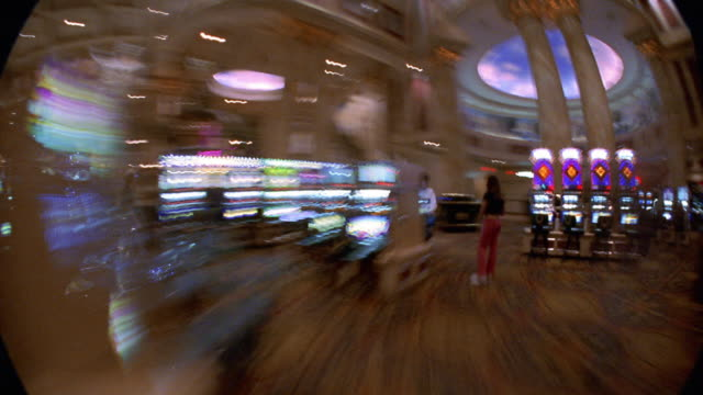 wide shot walking point of view time lapse past slot machines and people in casino / las vegas - casino interior stock videos & royalty-free footage