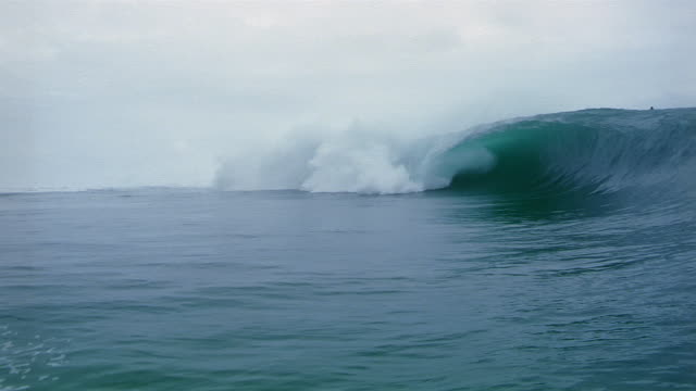 Wide shot Waves crashing in South Pacific Ocean/ Tahiti