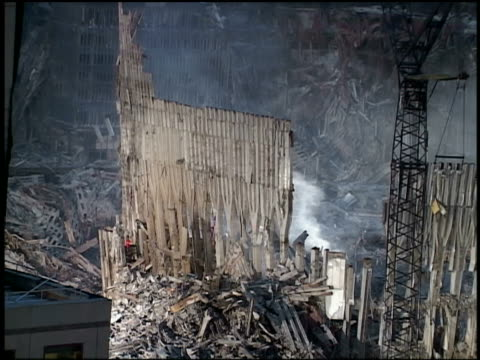 wide shot welding sparks and smoke rising at ground zero / nyc - rubble stock videos & royalty-free footage