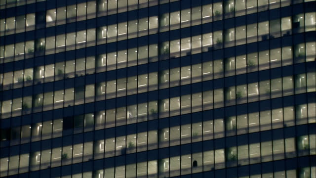 wide shot windows of office building at night/ tilt up windows/ london - rectangle stock videos & royalty-free footage