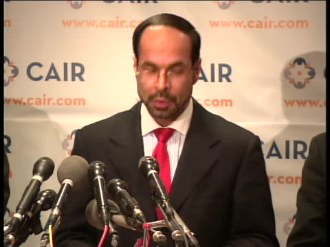 wide shot with a zoom in to medium shot of nihad awad executive director of the council for on american islamic relations speaks about the fort hood... - executive director stock videos & royalty-free footage