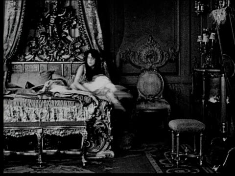 1916 b/w wide shot woman awakening in ornate bedroom and putting on robe - nightwear stock videos & royalty-free footage