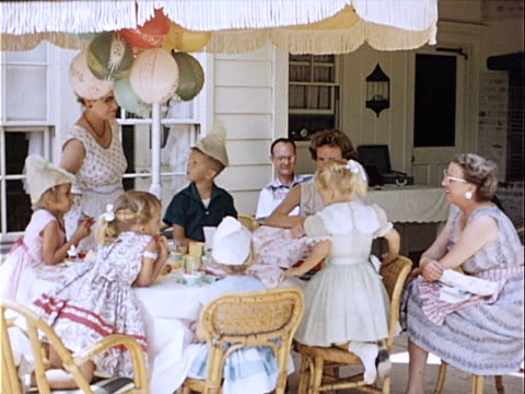 1954 wide shot woman unwrapping gift while family watches during birthday party celebration / california, usa  - 1950 stock videos & royalty-free footage