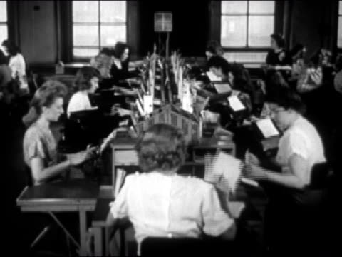 1946 wide shot women working as typists in telegram office - typing stock videos & royalty-free footage