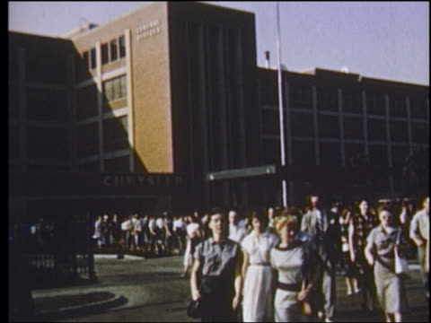 stockvideo's en b-roll-footage met 1951 wide shot workers leaving chrysler factory / detroit, michigan - chrysler