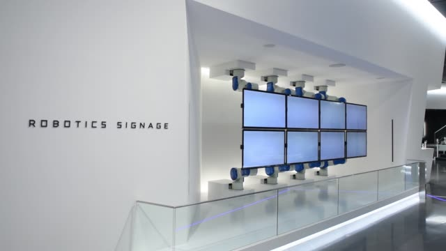 wide shot yaskawa electric corp motoman robots attached to liquid crystal display monitors are displayed at the companys showroom in kitakyushu japan - liquid crystal display stock videos & royalty-free footage