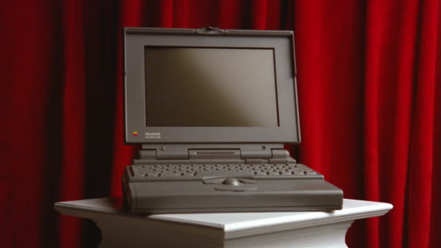 wide shot zoom in apple macintosh powerbook 170 laptop computer / close up - computer equipment stock videos & royalty-free footage