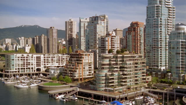 wide shot zoom in buildings on waterfront / vancouver - kelly mason videos stock videos & royalty-free footage