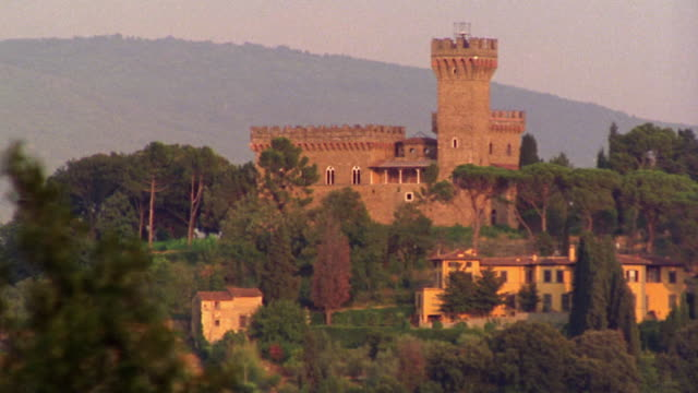 wide shot zoom in castle on hill / florence, italy - castello video stock e b–roll