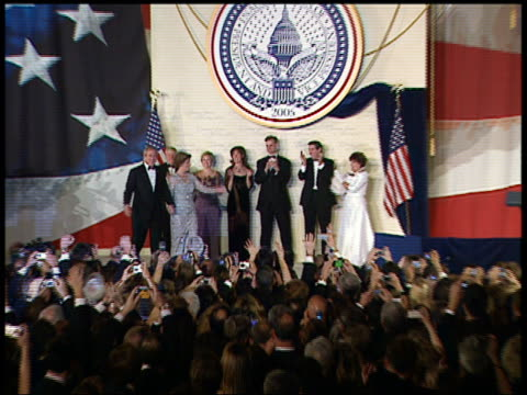 2005 wide shot zoom in george w and laura bush arriving at inaugural ball waving / audio / washington dc - 2005 stock videos & royalty-free footage