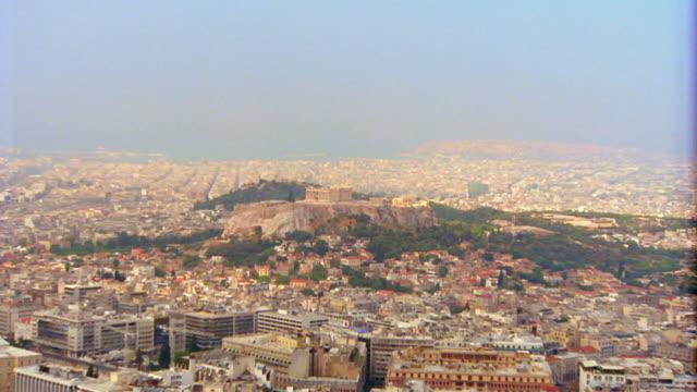 wide shot zoom in over athens to parthenon on acropolis / greece - parthenon athens stock videos & royalty-free footage