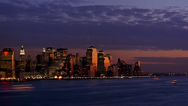 wide shot zoom in time lapse dusk to night lower manhattan skyline - dusk to night stock videos & royalty-free footage