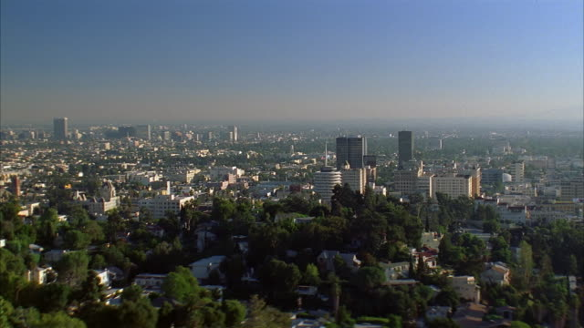 wide shot zoom in view of capitol records building + skyline / los angeles, california - 1998 stock videos & royalty-free footage