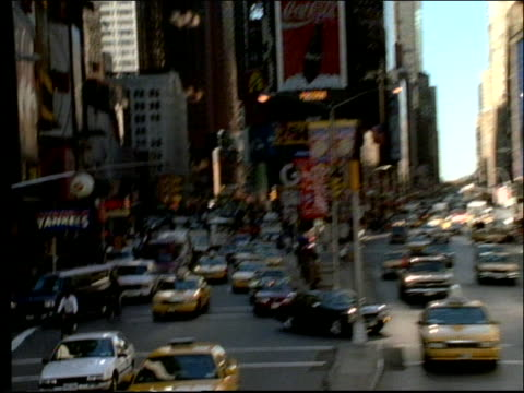 wide shot zoom in + zoom out of times square with traffic / nyc - anno 1997 video stock e b–roll