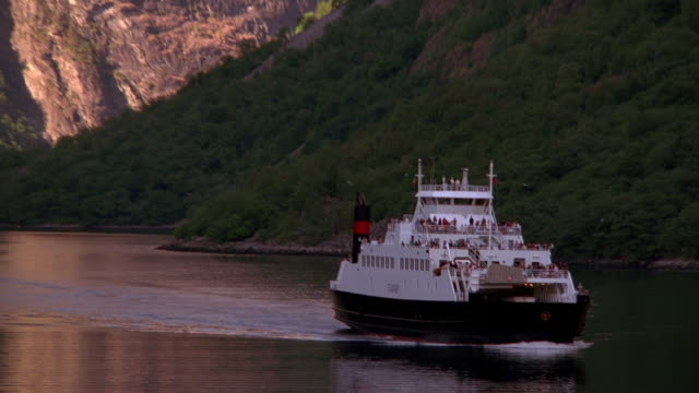 wide shot zoom out ferry boat traveling down fjord / norway - ferry stock videos & royalty-free footage