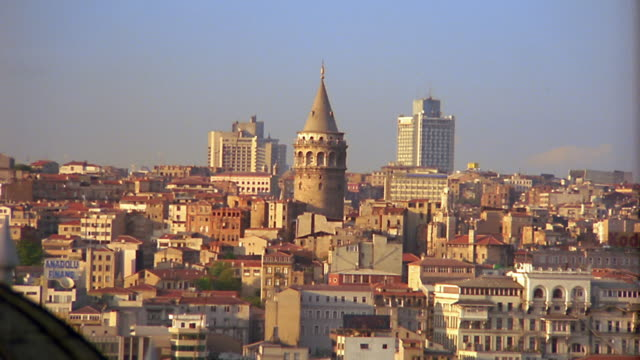 wide shot zoom out from galata tower surrounded by buildings to reveal cityscape / istanbul, turkey - 1995 stock videos & royalty-free footage