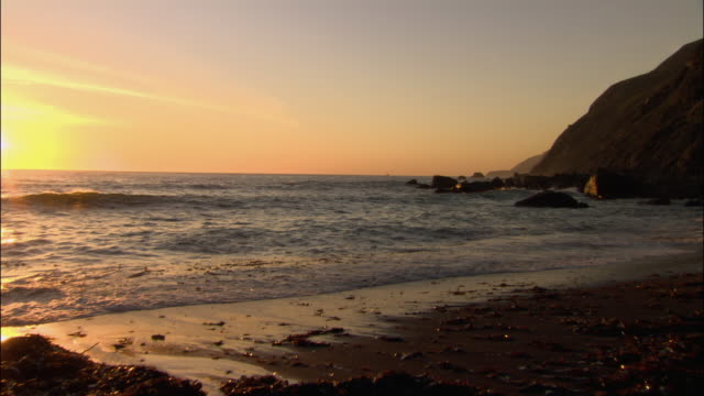 wide shot zoom out sunset over pacific / monterey county, california - ragged point stock videos and b-roll footage