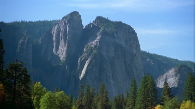 Wide shot zoom out view of the Cathedral Rocks and Yosemite Valley / Yosemite National Park, California
