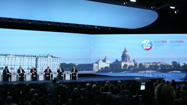 Wide shots left to right Geoff Cutmore anchor at CNBC Patrick Kron chief executive officer of Alstom SA Vladimir Putin Russias president Shiv Vikram...