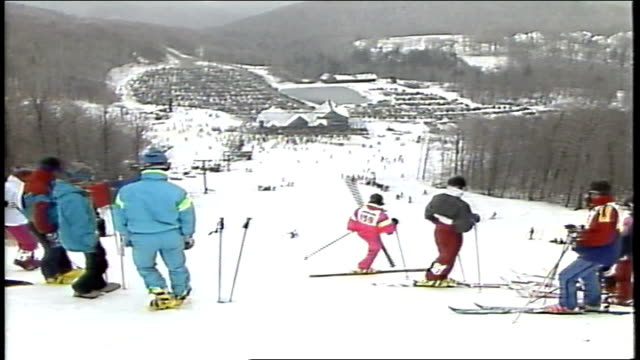 wide shots of mountain resort and skiers in killington, vermont - 1980 1989 stock-videos und b-roll-filmmaterial