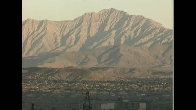 """wide shots of mountains rising behind kabul skyline, afghanistan; 1996. - """"bbc news"""" stock videos & royalty-free footage"""