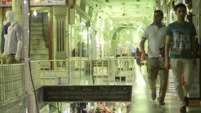 wide shots of people walking through narrow streets lined with shops and storefronts in erbil iraq close up shots beef hanging in a butcher shop... - dinar stock videos & royalty-free footage