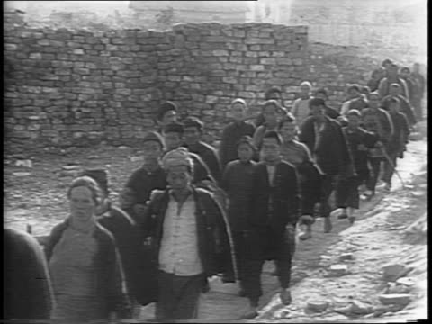 wide shots of rows of chinese civilians walking down a road and returning to their homes / wide and close up pans of the returned citizens standing... - one baby girl only stock videos and b-roll footage