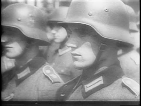 wide shots of rows of strategic nazi reserves in uniform with rifles marching and standing at attention / close up shot of otto ernst remer saluting... - rifle stock videos & royalty-free footage