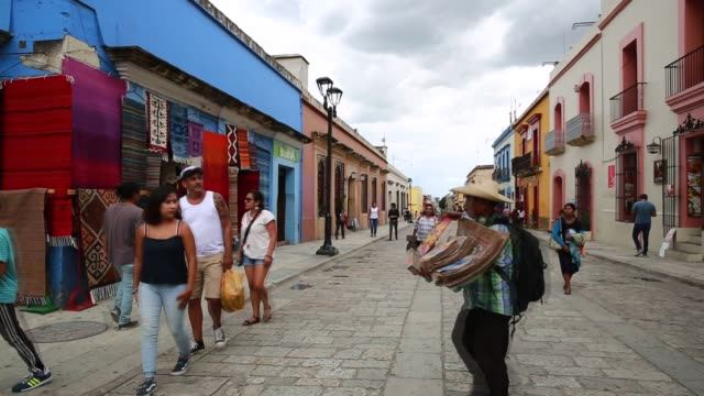 vidéos et rushes de wide shots of shops and customers walking down bus streets in oaxaca city, mexico on august, 19th photographer: susana gonzalez/bloomberg, shots:... - cactus