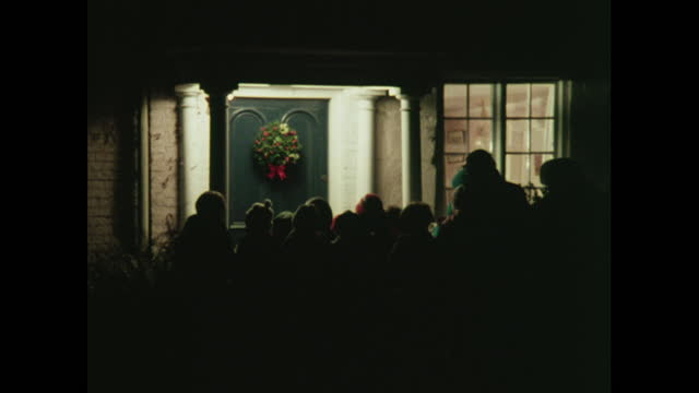 wide shots of silhouetted carol singers, 1970s - wreath stock videos & royalty-free footage
