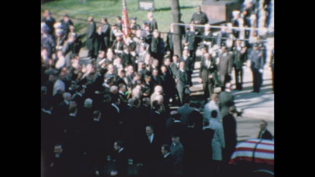 wide shots of the large crowd gathered in front of the cathedral of st. matthew the apostle for jfk's funeral service. - 使徒点の映像素材/bロール