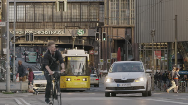 Wide slow motion shot of busy city intersection / Berlin, Germany