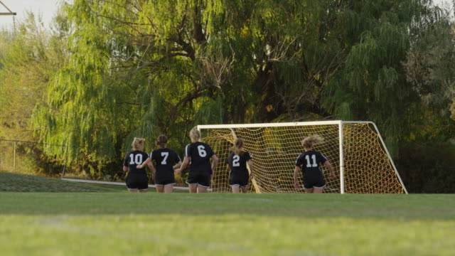 wide slow motion surface level shot of soccer players practicing / springville, utah, united states - springville utah stock videos & royalty-free footage