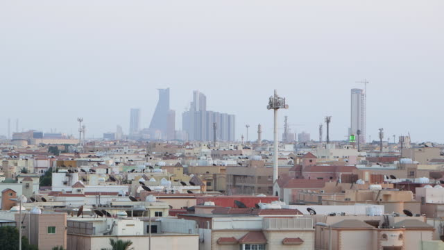 wide slow pan-right of jeddah skyline. - jiddah stock videos & royalty-free footage