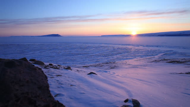 Wide, sunset over Greenland tundra landscape