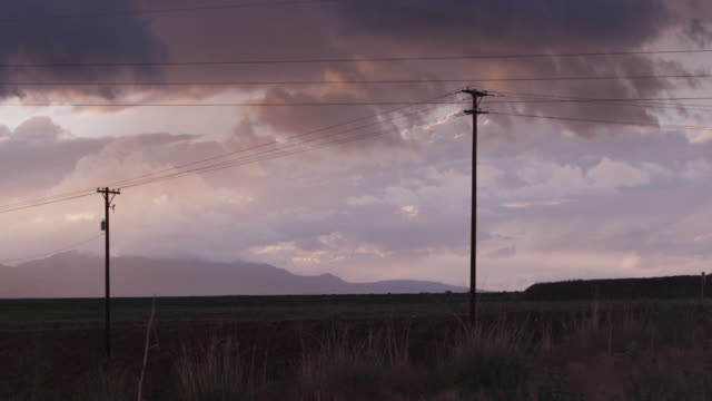 wide, telephone poles in vast utah landscape - telegraph pole stock videos and b-roll footage