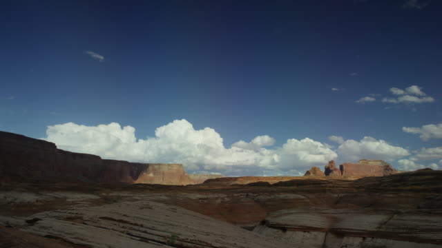 wide time lapse shot of clouds passing over desert landscape / lake powell, utah, united states - lake powell stock videos & royalty-free footage