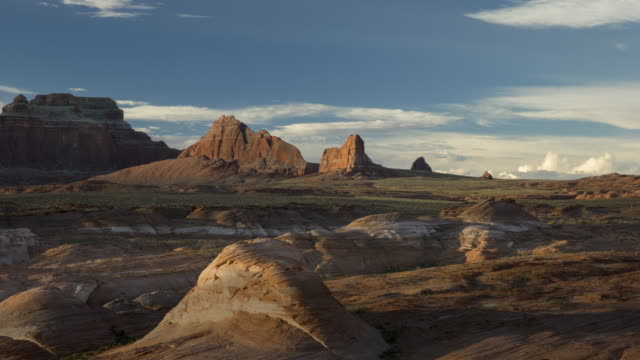 wide time lapse shot of clouds passing over rock formations in desert landscape / lake powell, utah, united states - lake powell stock videos & royalty-free footage