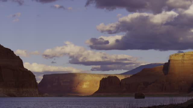 wide time lapse shot of rock formations and lake / lake powell, utah, united states - lake powell stock videos & royalty-free footage