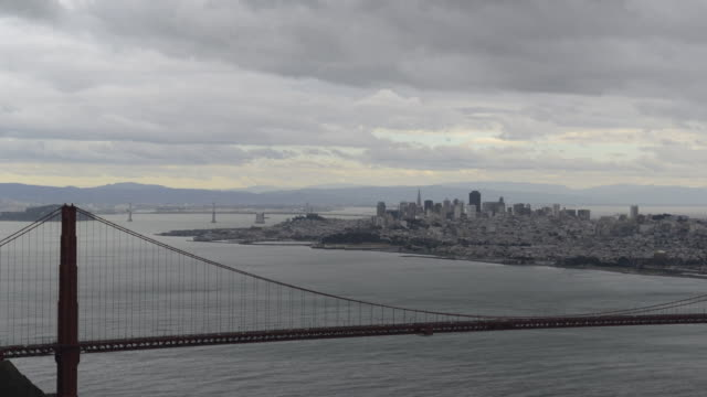 wide time lapse shots of the golden gate bridge on a rainy day in san francisco, california as ships pass underneath it, time lapse shots of rain... - golden gate bridge stock videos & royalty-free footage