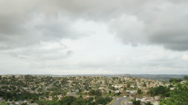 Wide timelapse, clouds roll over South African city