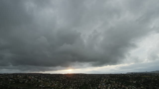 Wide timelapse, dark clouds over vast city in South Africa