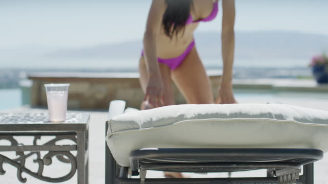 wide to close up panning shot of woman and deck chair / cedar hills, utah, united states - braunes haar stock-videos und b-roll-filmmaterial