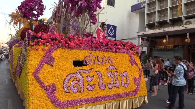 a wide to medium shot of front and side of decorated float this is the 38th annual flower festival - festival float stock videos & royalty-free footage