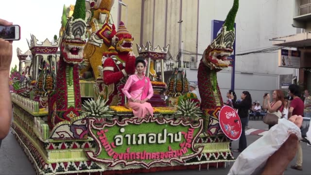 wide to medium shot of front of decorated float. this is the 38th annual flower festival. - festival float stock videos & royalty-free footage
