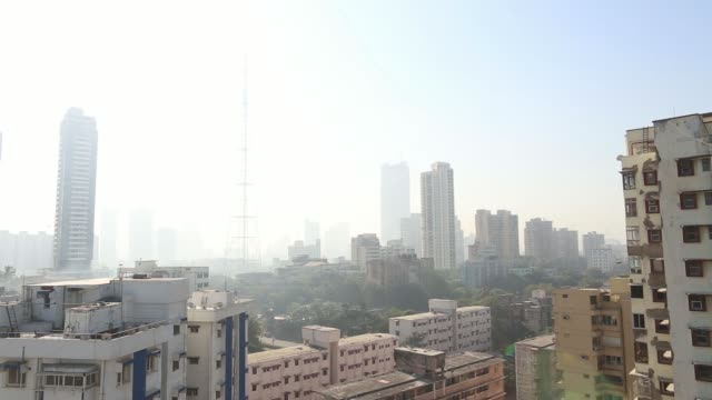 Wide view commercial and residential buildings and the pylon towers and the traffic on the Bandra Worli Sea Link High angle view of traffic on road...
