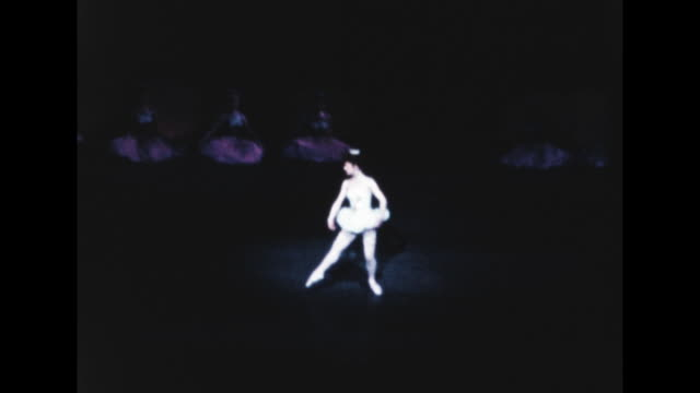 wide view of a solo ballet performer at radio city music hall - radio city music hall stock videos & royalty-free footage
